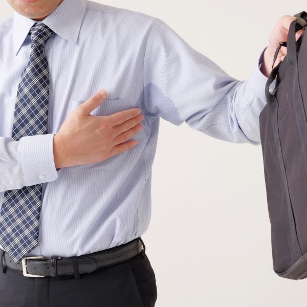 Man suffering from excessive sweating