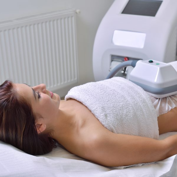 A woman undergoes a Fat Freezing procedure known as cryolipolysis