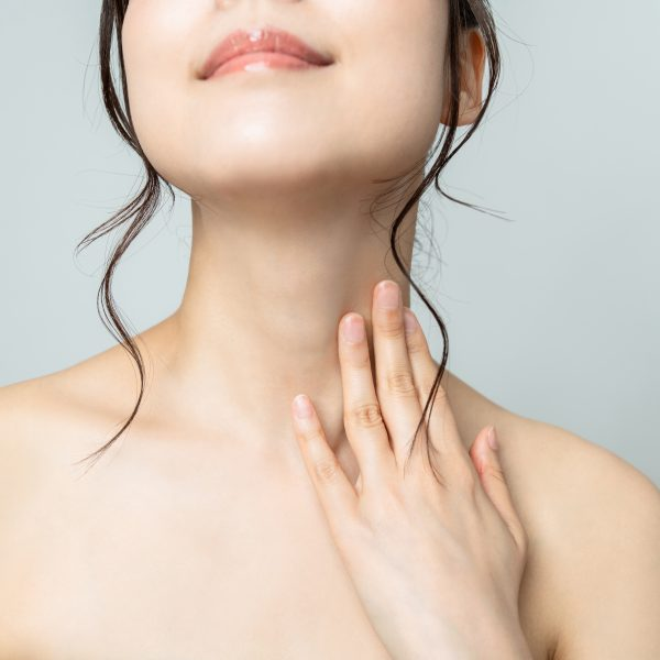woman showing smooth skin on her chin and neck, which can be achieved with hair v go treatment