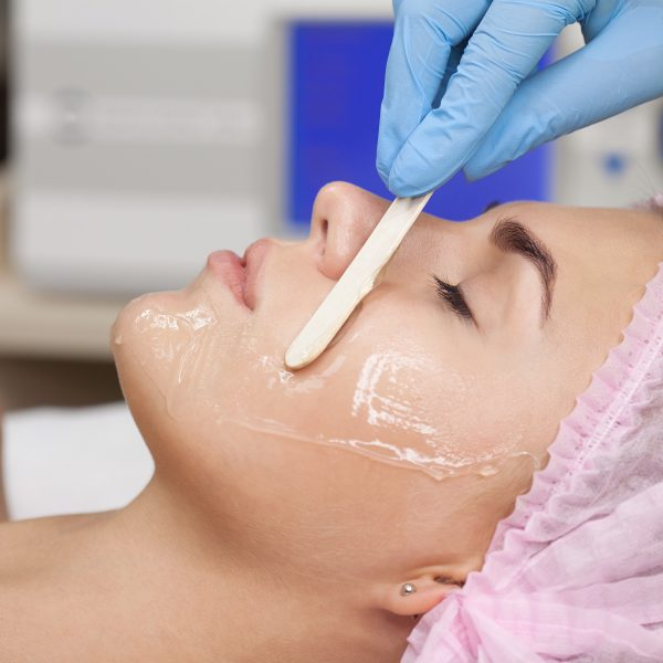 Woman is prepared for a facial treatment such as the Fire & Ice facial