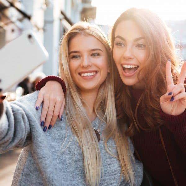 photo of girls taking selfies