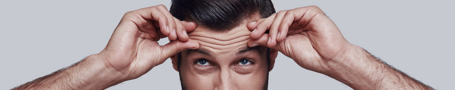male model demonstrates forehead lines and ageing concerns