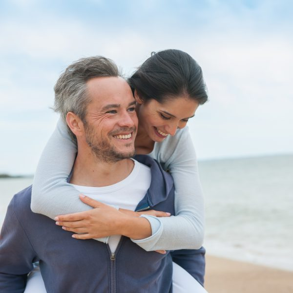 happy couple celebrate healthy living with glutathione IV shots