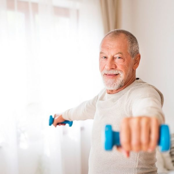 middle-aged man working out at home