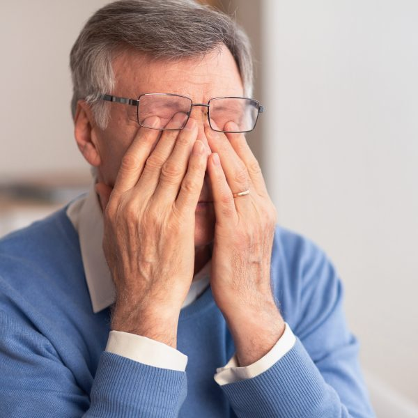 man suffering from migraine with aura