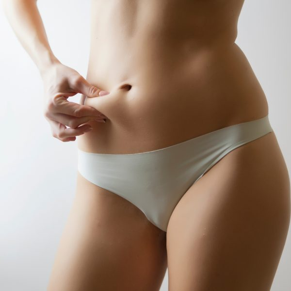 woman considering non-surgical body contouring liposuction such as BodyTite