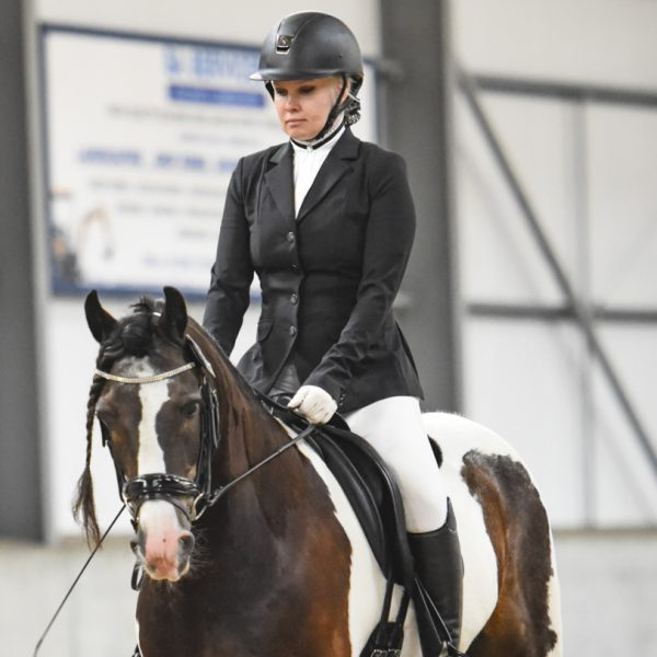 woman horserider competes in a dressage event