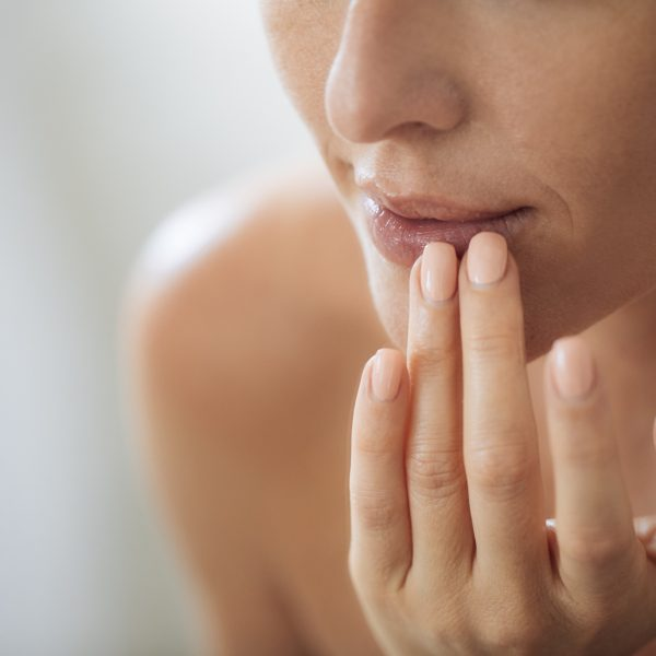 woman with lips concerns considers filler treatments
