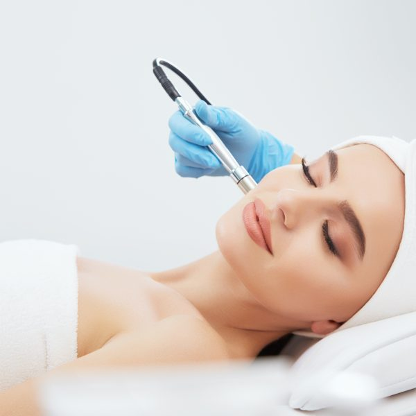 woman has microdermabrasion treatment on her face