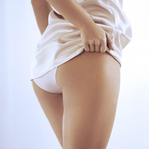 woman in underwear showing non-surgical bum lift results