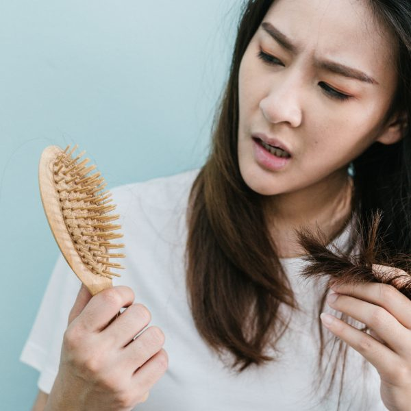 woman wondering what is causing her hair loss