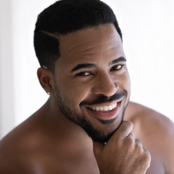 handsome black man promoting facetite for men face contouring treatment