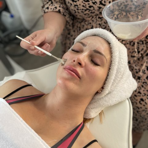 Beauty influencer Tracy Kiss is prepped for the DIBI Gold Leaf Facial at Vie Aesthetics