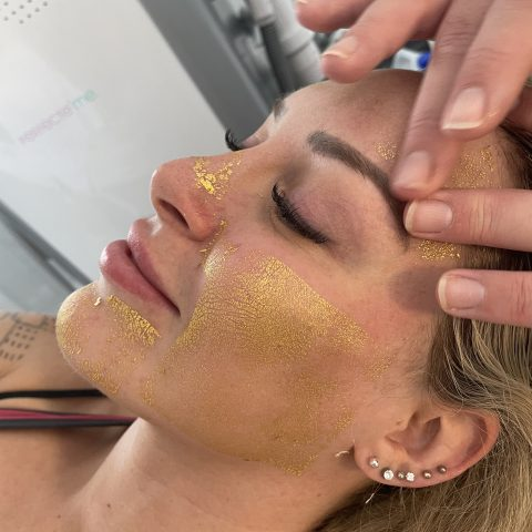 Beauty influencer Tracy Kiss has gold mask applied during her 24 Karat Gold Facial
